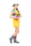 Female gardener holding two flowerpots Royalty Free Stock Image