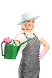 Female gardener holding a watering can Royalty Free Stock Photography