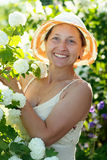 Female gardener in Roseum plant Royalty Free Stock Photo
