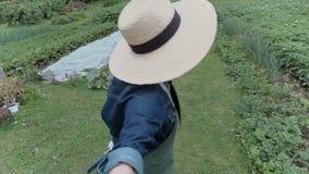 Female gardener showing the garden stock video