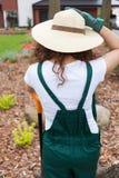 Female gardener standing in her garden Royalty Free Stock Image
