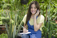 Female gardener taking an order Royalty Free Stock Photos