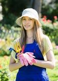 Female gardener in uniform Royalty Free Stock Photography