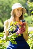 Female gardener in uniform Royalty Free Stock Photos