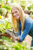 Female gardener using tablet computer Stock Image