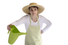 Female gardener with watering can Royalty Free Stock Photography
