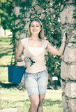 Female gardener with working tools outdoors Royalty Free Stock Photography
