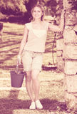 Female gardener with working tools outdoors Royalty Free Stock Images