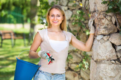 Female gardener with working tools outdoors Stock Image