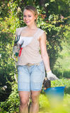 Female gardener with working tools outdoors Royalty Free Stock Image