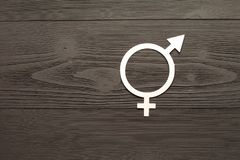 Female gender symbol of equality male, the concept of gender equality. Black wooden background. A paper-cut symbol of gender. Equality. Unique texture. 50/50 royalty free stock image