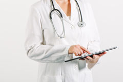 Female general medical practitioner using tablet computer Royalty Free Stock Images