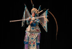 """Female generals in the black background- Beijing Opera"""" Women Generals of Yang Family"""". This opera tells a patriotic story how does an old woman of a Stock Images"""