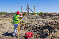Female geodesist is working with total station on a building sit Royalty Free Stock Images