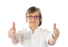 Female gesturing double thumbs up Stock Image
