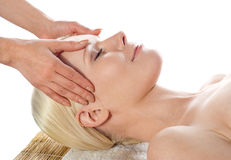 Female getting a head massage and facial Royalty Free Stock Images