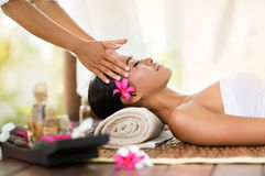 Female getting recreation massage of head Stock Photography