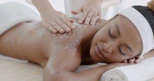 Female Getting A Salt Scrub Treatment Royalty Free Stock Photo