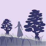 Female Ghost. A female character who walks in the fog between two large trees Royalty Free Stock Images