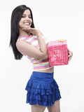 Female with a gift box. Girl of indian origin with a gift box Stock Photography