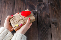 Female give present wrapped craft paper Stock Image