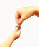 Female Giving Coin To Another Person, Isolated On Royalty Free Stock Image