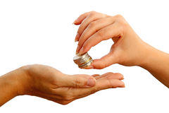 Female giving stack of coins to another person Stock Image