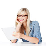 Female with glasses and tablet stock image