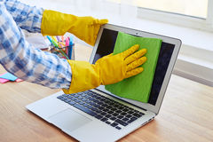 Female in gloves cleaning with mop display of laptop Royalty Free Stock Photo