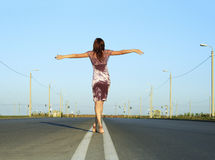Female go away on empty road Stock Images
