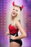 Female go go dancer.  girl wearing devil horns Royalty Free Stock Photos