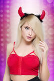 Female go go dancer.  girl wearing devil horns Stock Images