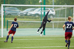 Female goalkeeper returns ball over bar Stock Images