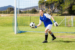 Female goalkeeper about to throw a football. In field Stock Photos