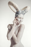 Female with goat body-art Stock Photography