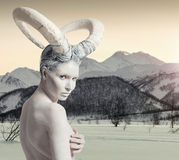 Female with goat body-art. Over winter countryside background. Dedicated to Chinese Horoscope 2015 - Year of the Goat (Sheep Royalty Free Stock Photos