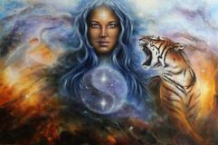 The female goddess Lada in spacial surroundings with a tiger and a heron