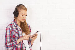 Female going through playlist Stock Images