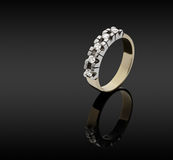 Female gold ring with diamonds Stock Image