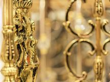 Female golden statuette, decorative item of interior royalty free stock photography