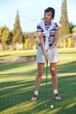 Female golf player Stock Image