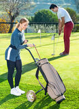 Female golf player choosing right club Royalty Free Stock Images