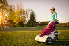 Female golf player with golf bag. stock photography