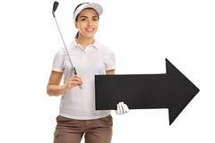 Female golf player holding golf club and arrow Stock Photos