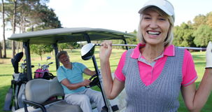 Female golf player interacting with man stock video footage