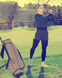 Female golf player looks successfully after the golf game Stock Image
