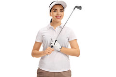 Female golf player posing with golf club Royalty Free Stock Image