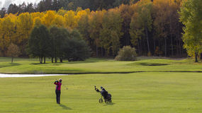 A female golf player swinging. A beautiful autumn day at the golf course. A female golf player swinging. Photo taken on October, 2010, Sollentuna Golf Course Stock Image
