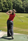 Female golfer. Back view of female golfer Stock Images