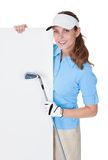 Female golfer with blank board Stock Photography
